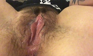 Rub my hirsute clitoris and receive my fingers soaked