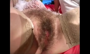 Blonde milf breaks some butt with her fist