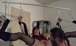 Rhianna shackled up in swing pt 1