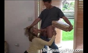 Ava devine with a pizza delivery chap