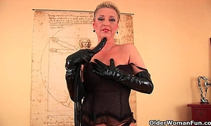 Perverted granny betty is dildoing her old slit