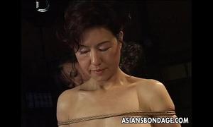 Asian chick in rope thraldom scene