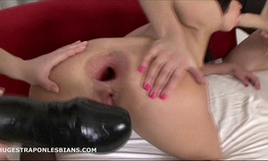 Alisya has her anus gaped by allies with massive ding-dong dildos