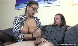 Busty milf enjoys jerking a weenie