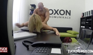 Horny golden-haired secretary copulates her boss in the office