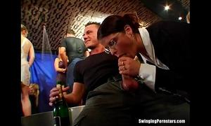 Slutty party hotties engulfing ramrods in club fuckfest