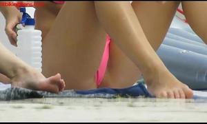 Hot bikiniteens with micro straps tanning