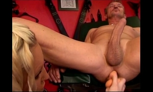 Hot golden-haired rubbing her slave's butthole