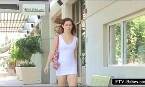 Teen honey showing her hairless cunt upskirt outdoor