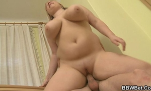Busty plumper enjoys riding and engulfing his large weenie