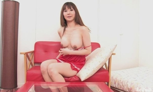 Asian bombshell fucks herself with double-sized dildo