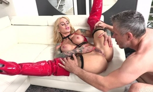 Tattooed MILF with big honkers gets her pierced pussy drilled