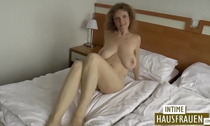 Brunette milf with hanging mounds