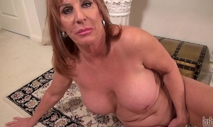Big titted aged mom on the rug in costume