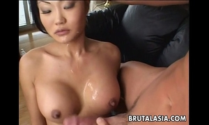 Asian dark brown floozy sucks and acquires booty drilled real coarse